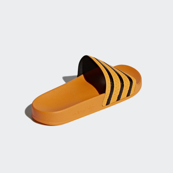 3fbfd685726bc8 ... Adilette Slides Real Gold Core Black Real Gold CQ3099 arrives 25386  fcaf1  Adidas ...