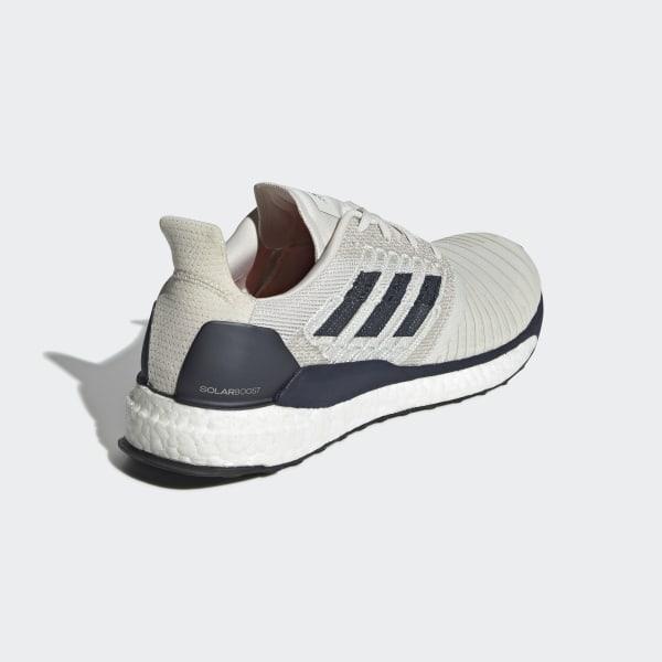72f09b58c9a15 SolarBoost Shoes Raw White   Legend Ink   True Orange D97435