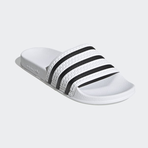 90a4401820c4 Adilette Slides White   Core Black   White 280648