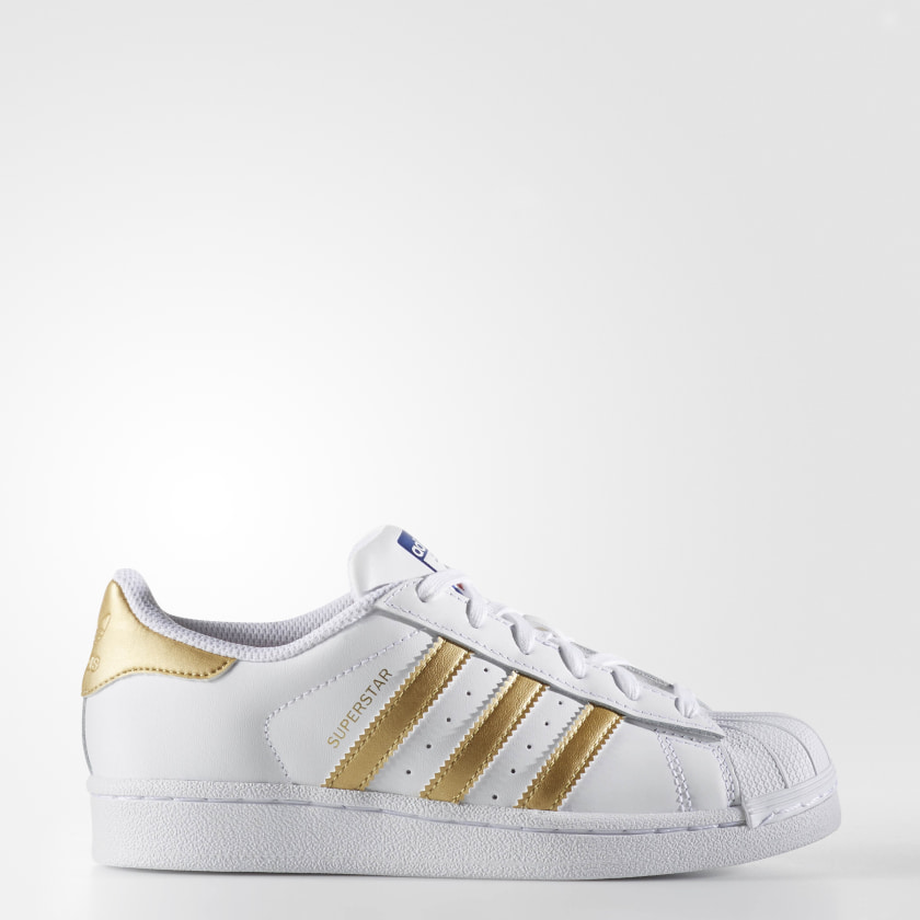 white adidas shoes with gold