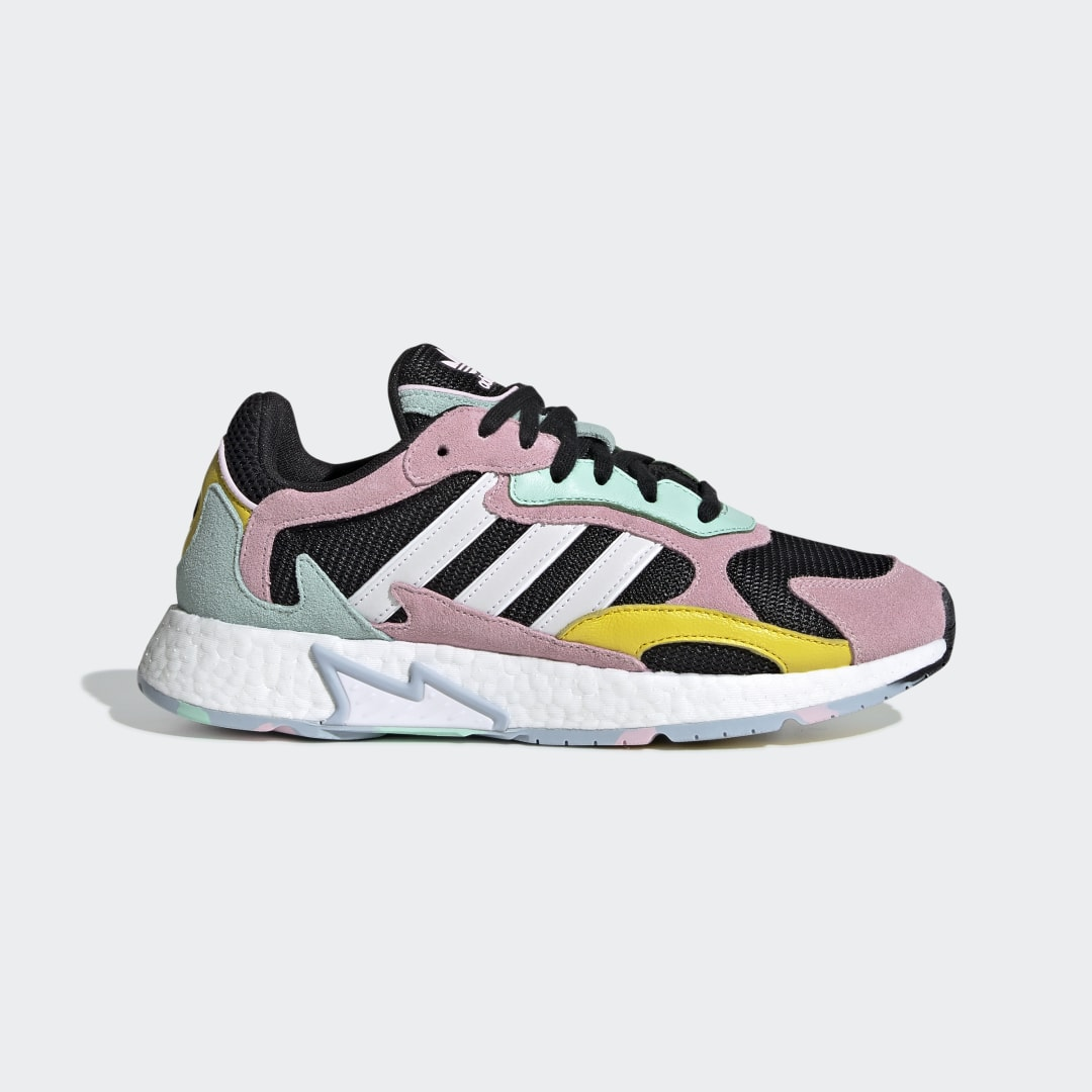 adidas Inspired by running shoes from the \\\'90s, these shoes combine vintage technical style and modern cushioning. They feature a layered upper with reflective 3-Stripes. A Boost midsole gives responsive comfort. Finished with a flame-shaped midsole plug and a multicolored rubber outsole.
