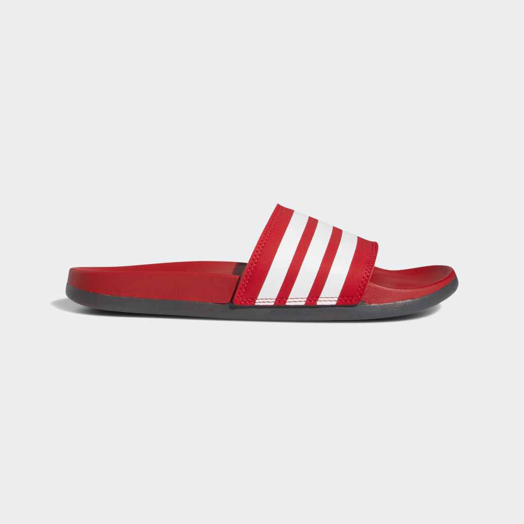 adidas Rejuvenate tired feet in these slides for men. The lightweight slides have a Cloudfoam Plus contoured footbed that delivers plush cushioning with every step. The classic design features a bandage upper with contrast 3-Stripes.
