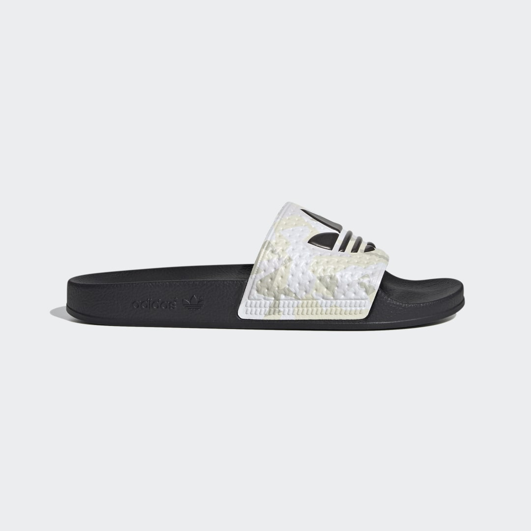 adidas We\\\'re not saying that these adidas Adilette Slides act as a good omen for the day to come, but they sure set the tone for a fun one. Right off the bat, they leave the fuss at the door, letting you slip into them in, literally, a second. And once they\\\'re on, it\\\'s full, uninterrupted comfort. Until you take them off to jump in the nearest body of water, that is. Even if that happens to be hundreds of miles away. Did we mention these are the perfect airplane shoes?