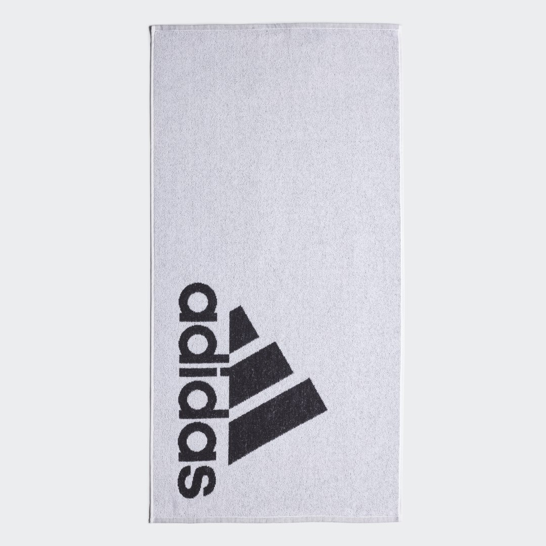 adidas Dry off with the cotton comfort of this towel. The small-size towel is made of lightweight, quick-drying fabric that\'s soft and durable.