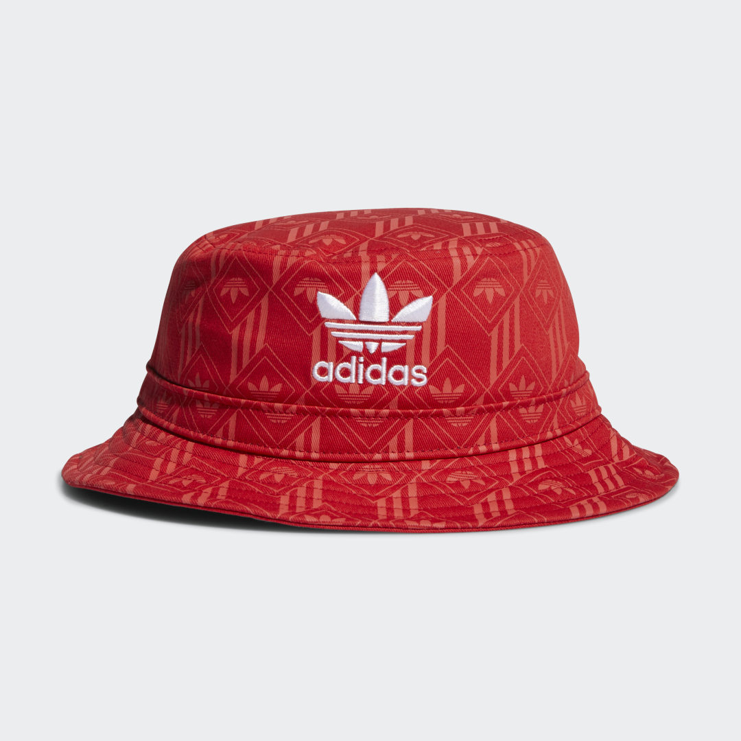 adidas Feel good, look good. But don\\\'t get too comfortable. This soft cotton bucket hat upgrades the ordinary with a bold graphic design that stands out on the street with a distinctive look. An embroidered Trefoil logo adds an authentic adidas edge.