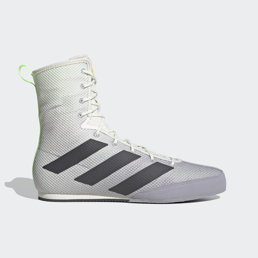 adidas Stay light on your feet until the final bell sounds. These boxing shoes leave an impression with an eye-catching breathable mesh upper that hugs the foot for bout-winning support. Extra stability is provided by the mid-cut design and inner reinforcements. A thin EVA midsole gives you direct contact with the canvas.