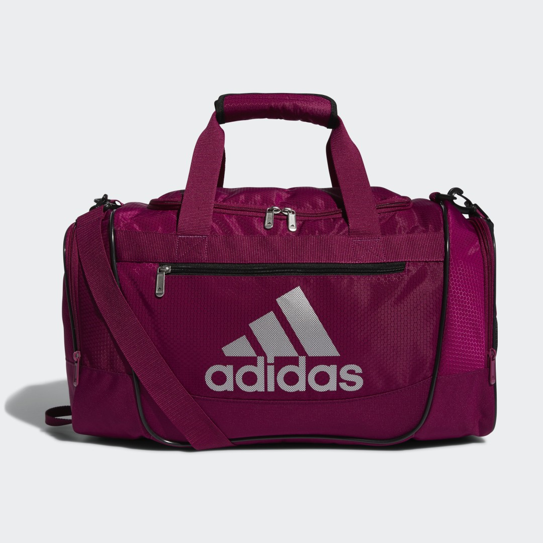 adidas No need for a big and bulky bag when you\\\'re headed to the gym. This compact duffel has plenty of room and three outer zip pockets to keep any post-workout, aka sweaty, clothes or trainers away from the rest of your haul. Odor-fighting action is built in, so a stinky gym bag is one thing you don\\\'t have to worry about.