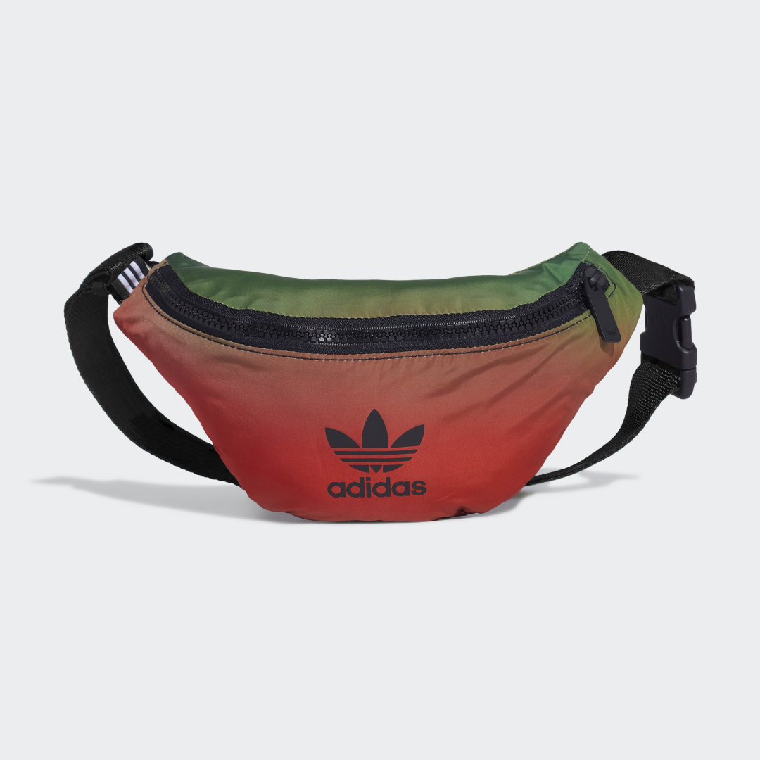 adidas Be it clothes or accessories, Paolina Russo brings all her passions to life in every piece she designs. She grew up playing sports and loves using its aesthetics in her designs. Her love for sculpting influences every pattern she draws and allows her to always make bold statements.​​This waist bag is designed with a simple, chic silhouette and is decorated with a gradient print that pays homage to the world of sports. A wardrobe essential that will give your arms more freedom to move while giving your outfits more waist.​​Wear it as a belt with the coat of this same collection or cross-body over an oversized tee and a pair of jeans.