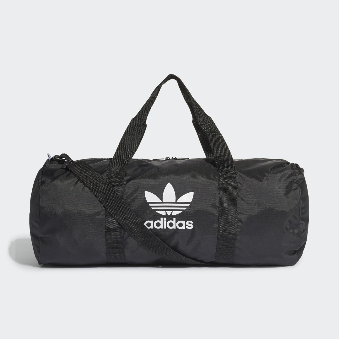 adidas A sporty duffel for your daily outings. The clean, simple design proudly shows off a contrast Trefoil logo on the side. The webbing handles are top-stitched for extra durability when the bag is fully loaded.