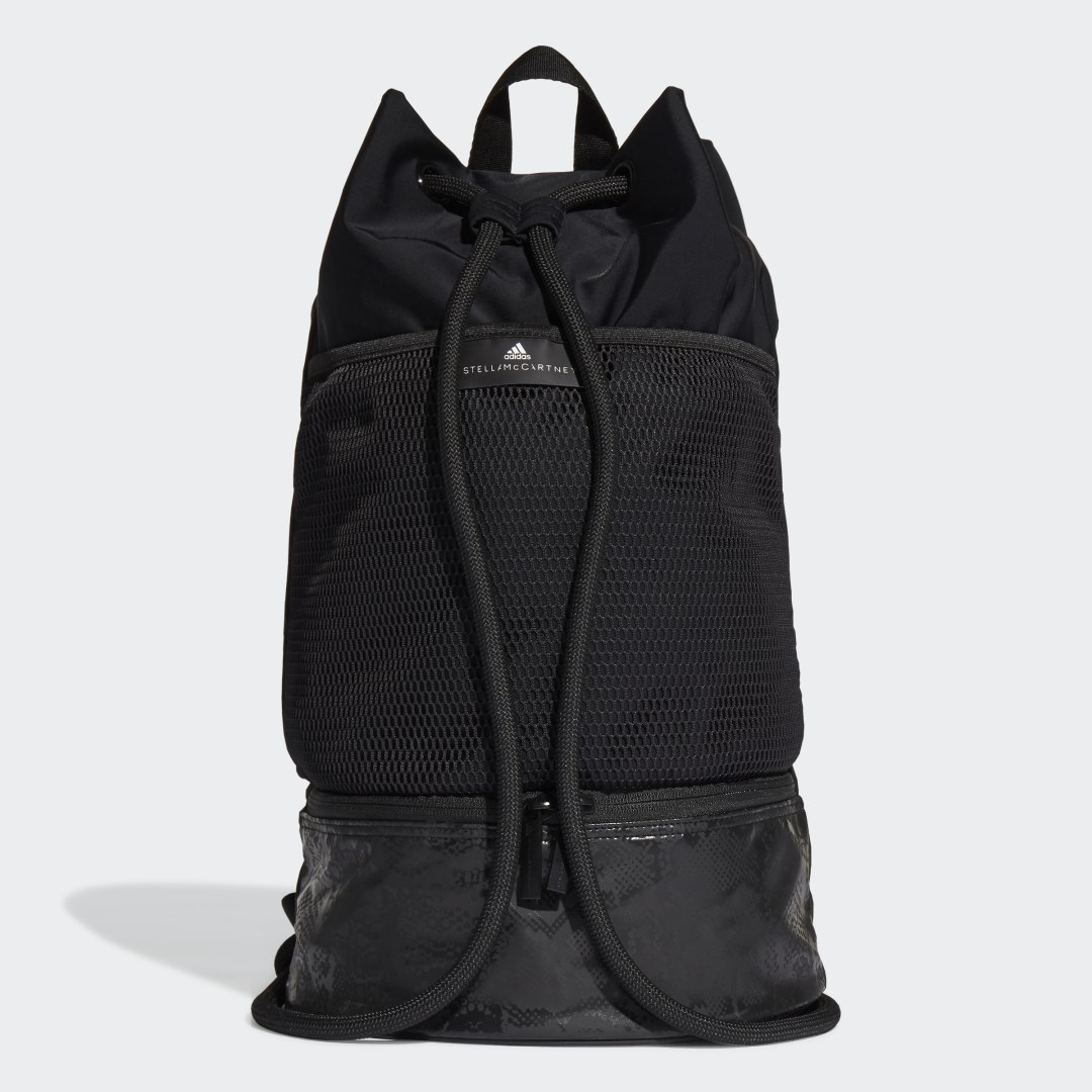 adidas Since their first collaboration in 2005, adidas and Stella McCartney have continued to bring a high-fashion edge to sportswear essentials. A sheer mesh pocket wraps around this Gym Sack, keeping fueling snacks, hand wraps and small towels accessible. After your workout, throw your sweaty trainers in the lower shoe compartment to keep them separate from the rest of your gear.