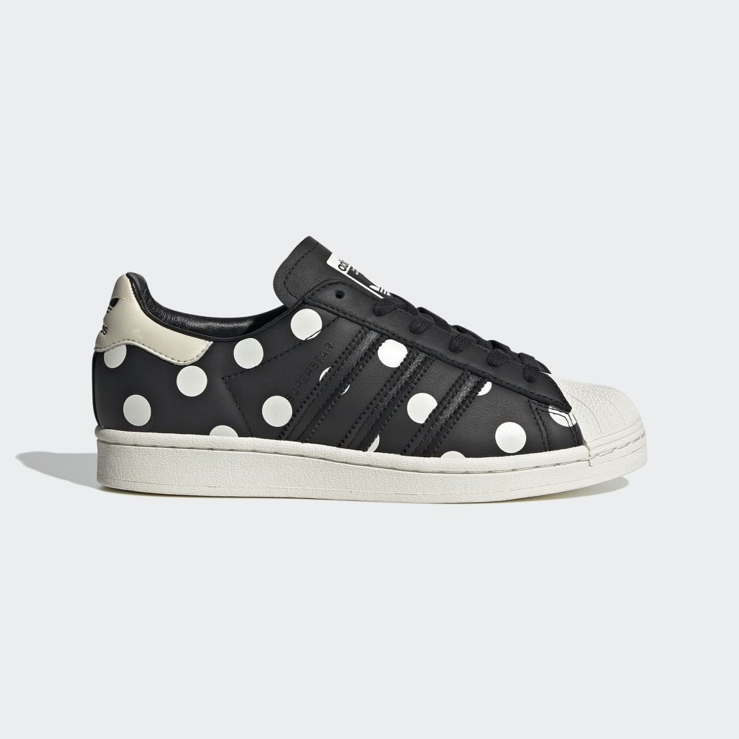 adidas Some call them iconic. Others call them retro. But you can just call this pair cute. For over 50 years, adidas Superstar Shoes have been stealing glances from the basketball court to the arena stage. Make sure you carry on the tradition of getting noticed when you lace up in these classic shell-toe shoes. A playful polka-dot pattern covers the sleek leather upper for a charming update to this heritage silhouette.