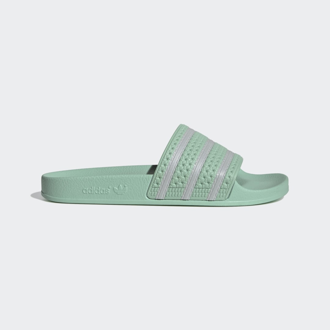 adidas It\\\'s not a ritual thing. It\\\'s a comfort thing. There\\\'s a reason you go for your adidas Adilette Slides every morning. You like feeling good. With the reflective 3-Stripes on this pair, you\\\'ll stand out a little more than usual. But not so much that you can\\\'t cruise through the day under the radar. Just enough to catch some attention once you slow down.