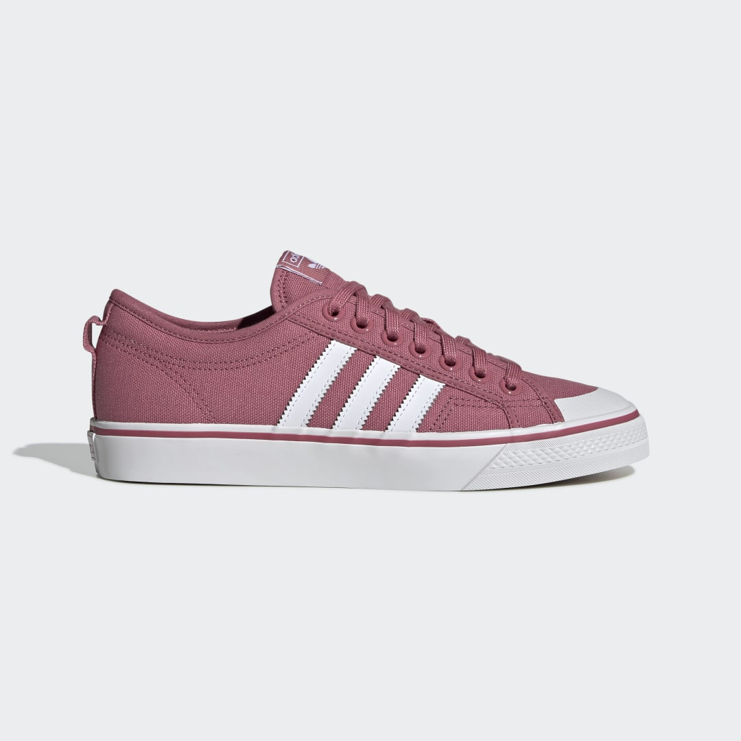 adidas As a defining look of \\\'80s B-ball style, the Nizza offered a lightweight textile alternative to traditional leather designs. This version reworks the original as a versatile low top shape. These shoes come with a thick, naturally breathable canvas upper and a distinctive rubber toe bumper.