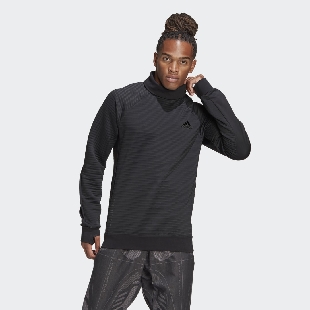 adidas The weather changing is inevitable. So while you can\\\'t control that force of nature, you can control your comfort level, and you can do it without sacrificing style. Throw on this adidas sweatshirt and finally understand what can be so good about the cold. The insulated build lets you step out without wanting to step right back in.