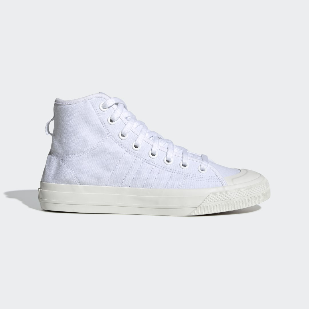 adidas The Nizza Hi RF reworks an \\\'80s B-ball design from a fresh and modern point of view. These high top shoes show off an exaggerated toe bumper and high sidewalls that add streetwise swagger. The canvas upper is sturdy and naturally breathable. Stitched details add a refined touch.