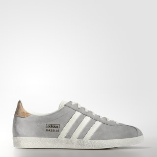 save off 0eaed fb90e Zapatillas Casuales Gazelle OG Mujer MGH SOLID GREY  OFF WHITE  GOLD MET.  M19556