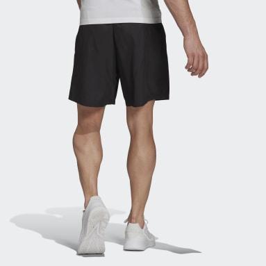 Men Sport Inspired Black Essentials Logo Woven Shorts