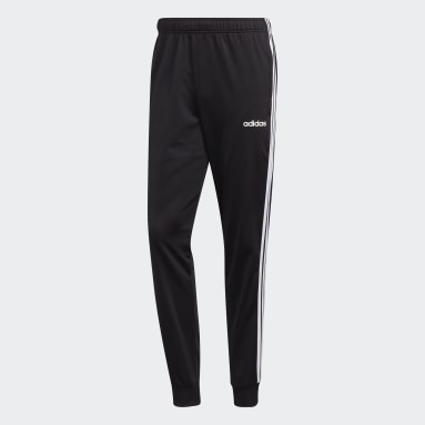 Pants Essentials Tapered Tricot 3 Franjas Negro Hombre Diseño Deportivo