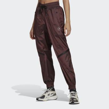 Pantaloni da allenamento adidas by Stella McCartney Shiny Woven Rosa Donna adidas by Stella McCartney