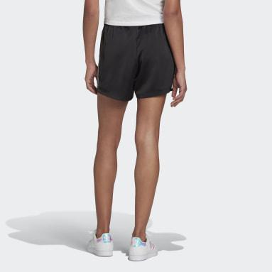 ผู้หญิง Originals สีดำ กางเกงผ้าซาตินขาสั้น Adicolor Classics