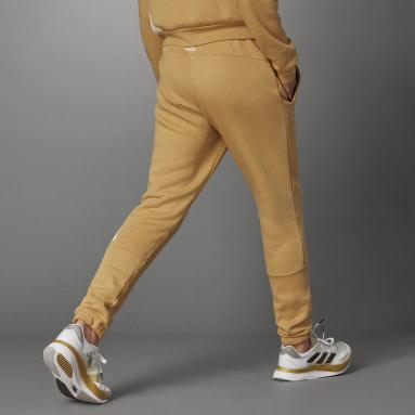 Muži Sportswear béžová Kalhoty Logo