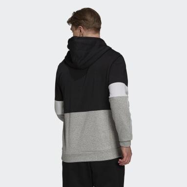 Sudadera Essentials Fleece Colorblock Negro Hombre Sportswear