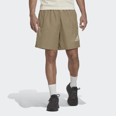 ผู้ชาย Sport Inspired สีเขียว กางเกงขาสั้นผ้าทอ Essentials Logo