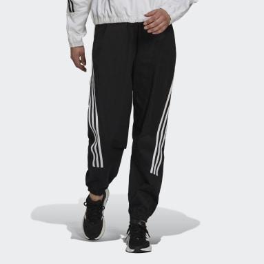 ผู้หญิง Sport Inspired สีดำ กางเกงขายาวผ้าทอ adidas Sportswear Future Icons