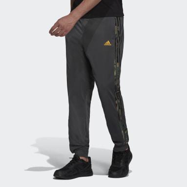 Men's Essentials Grey Primegreen Essentials Warm-Up Tapered 3-Stripes Camo Track Pants