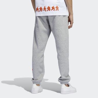 Muži Originals šedá Sportovní kalhoty Logo Play