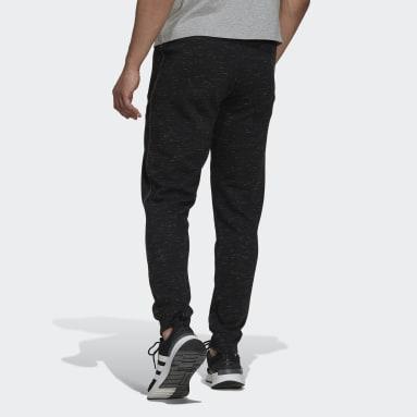 Pantalón Essentials Mélange Negro Hombre Sportswear