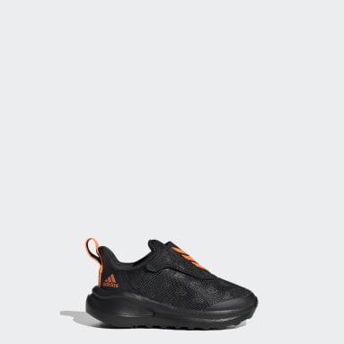 Chaussure de running/football FortaRun 2020 Noir Enfants Running