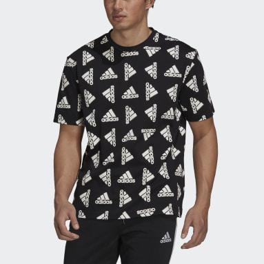 Camiseta Essentials Loose Giant Logo (Género neutro) Negro Hombre Sportswear