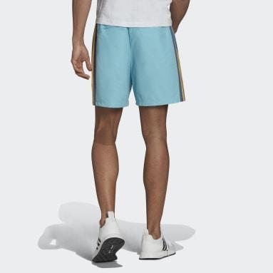 ผู้ชาย Originals สีเทอร์คอยส์ กางเกงขาสั้นกันลม Human Made