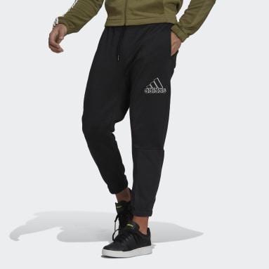 Pantaloni Essentials Polar Fleece Nero Uomo Sportswear