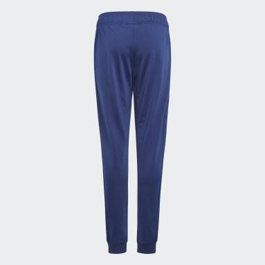 Kluci Originals modrá Kalhoty Allover Print SST
