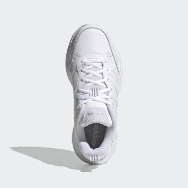 Women Walking White Strutter Shoes