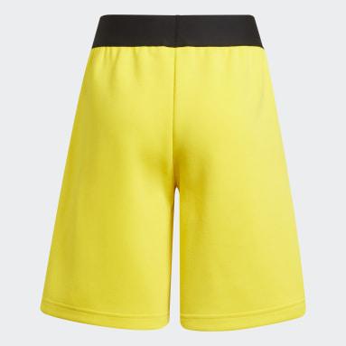เด็ก เทรนนิง สีเหลือง กางเกงขาสั้นมีกระเป๋าซิป adidas x Classic LEGO®