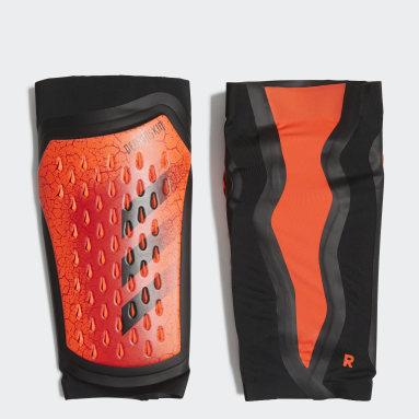 оранжевый Футбольные щитки Predator Pro