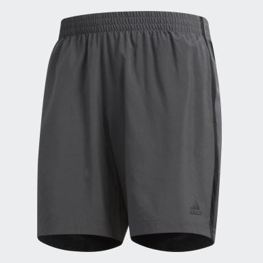 Shorts Own the Run Gris Hombre Running