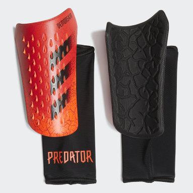 оранжевый Футбольные щитки Predator Competition