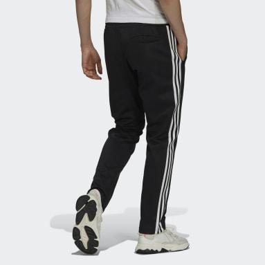Muži Originals černá Sportovní kalhoty Adicolor Classics Beckenbauer Primeblue