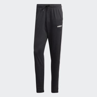 Pants Essentials Tapered Open Hem 3 Franjas Negro Hombre Diseño Deportivo