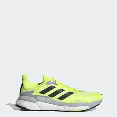 Men Running Yellow SolarBoost 3 Shoes