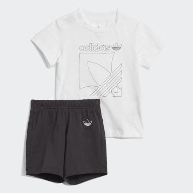 Conjunto Shorts y Polera Badge (UNISEX) Blanco Niño Originals