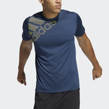 Men Training Blue FreeLift Badge of Sport Graphic Tee