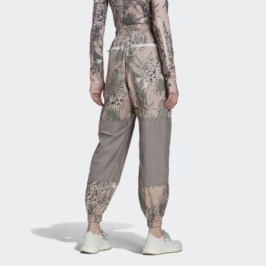Ženy adidas by Stella McCartney růžová Kalhoty adidas by Stella McCartney Future Playground Woven