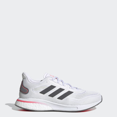 Women Running White Supernova Shoes