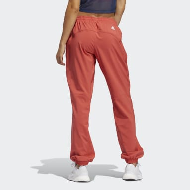 Pantaloni Woven Badge of Sport Rosso Donna Running