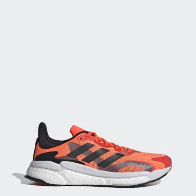 Men Running Orange Solarboost 3 Shoes
